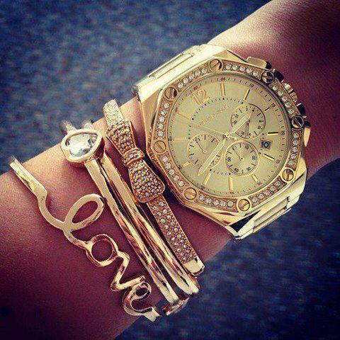 altıgen taşlı gold saat modeli