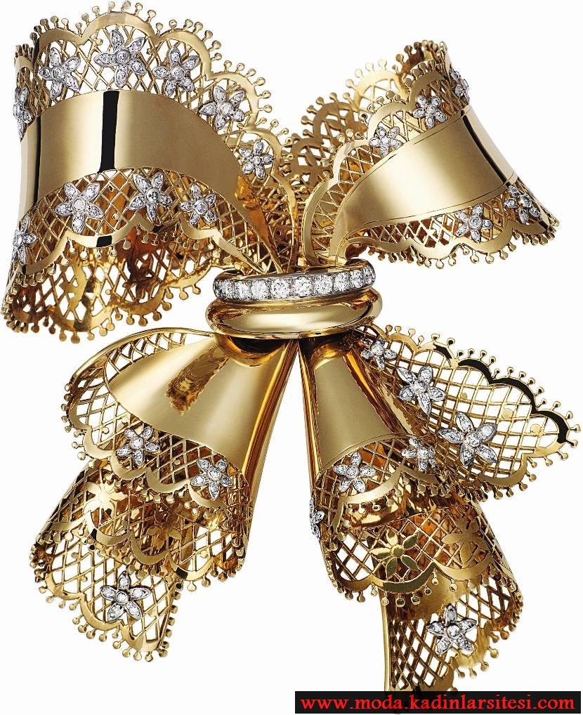 altın fiyonk figürlü pırlanta broş modeli
